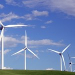 How do windmills create electricity based on wind speed